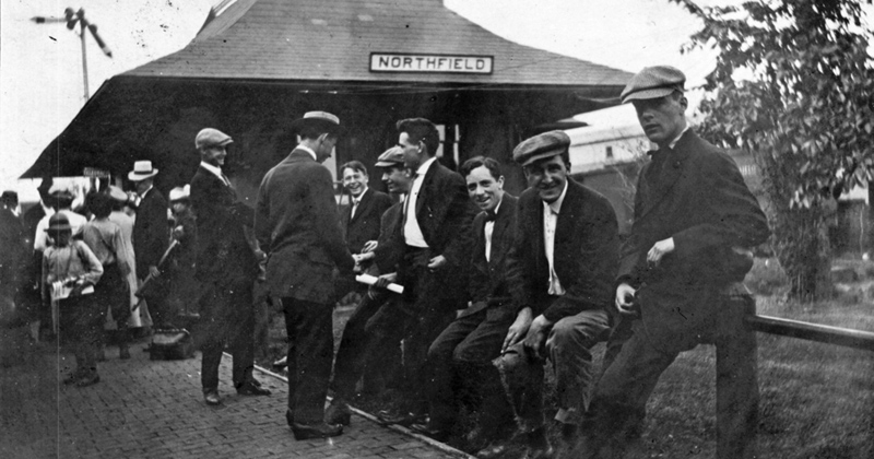 people waiting at the 1888 depot